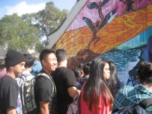 High school students in front of a new mural
